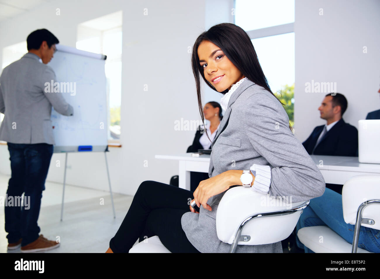 Business conference. Business meeting. Business people in formalwear discussing something while sitting together - Stock Image