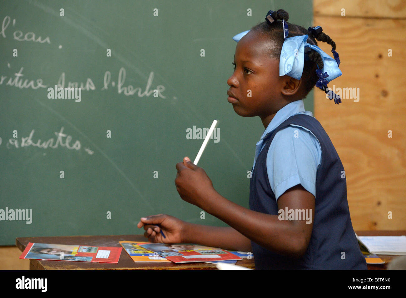 Student in a school for earthquake refugees, Fort National, Port-au-Prince, Haiti - Stock Image