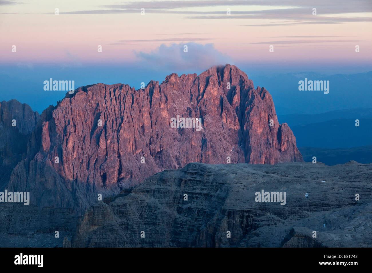 View from Pordoi Pass of mountains Sellastock and Langkofel or Sasso Lungo at dusk, Dolomites, South Tyrol, Alto - Stock Image