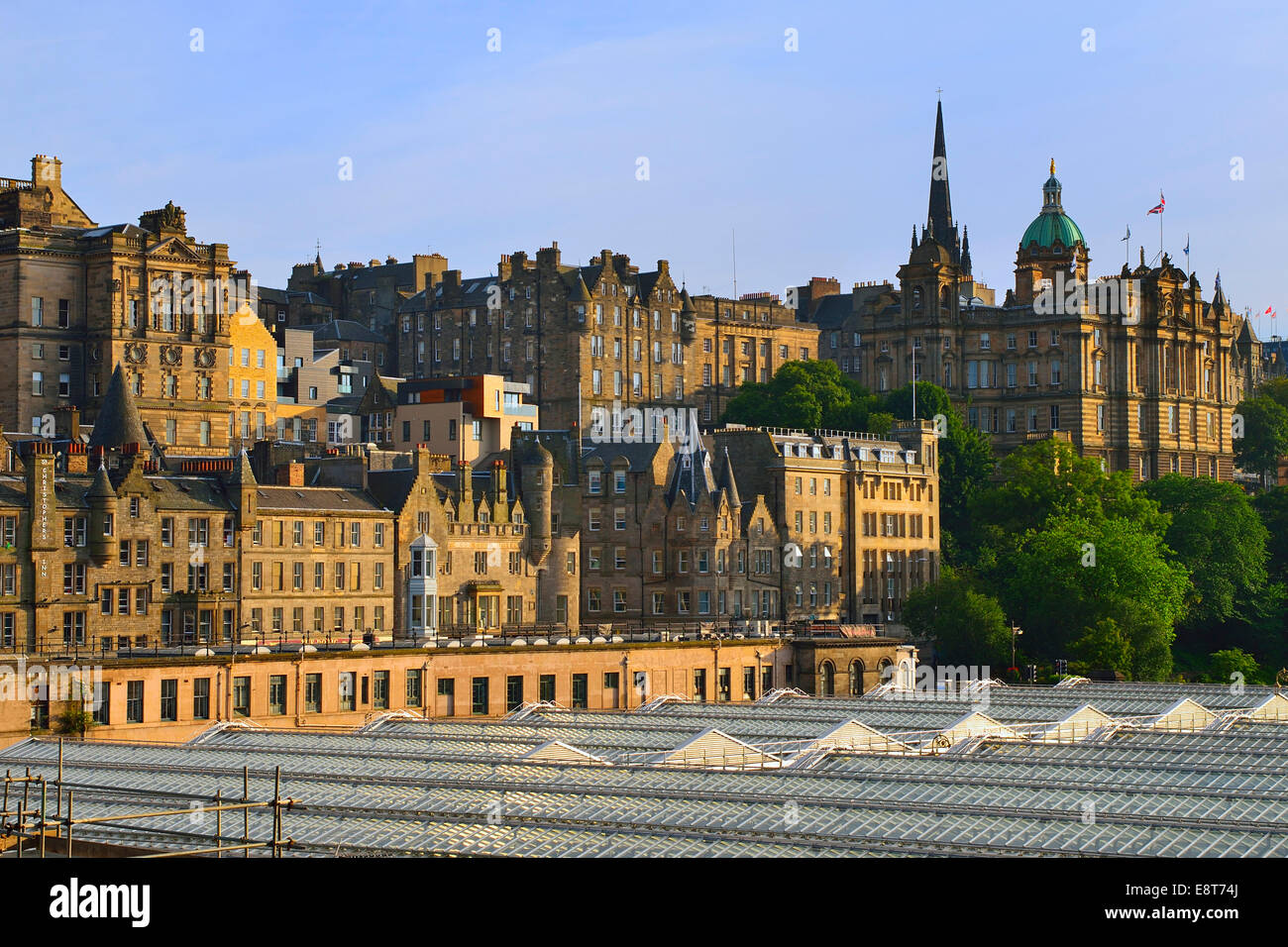 View over the roof of the main station on the city with the University of Edinburgh, Edinburgh, Scotland, United - Stock Image