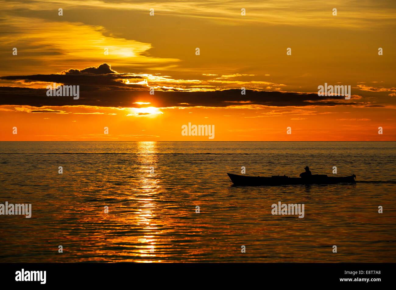 Sunset, boat, Sulawesi, Indonesia - Stock Image