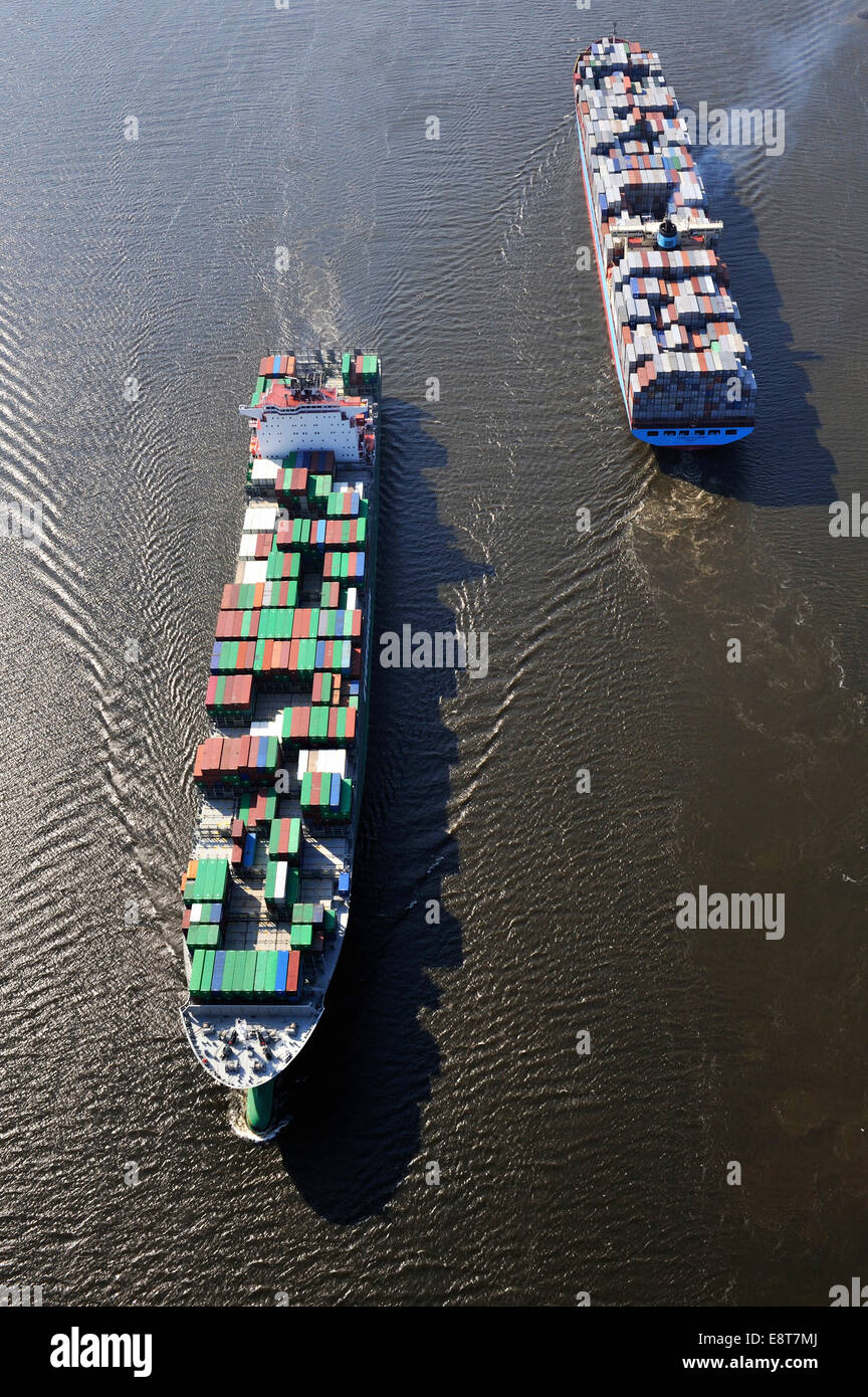 Aerial view, container ships Ever Conquest, left, and Charlotte Maersk, right, on the Elbe River, Hamburg, Germany - Stock Image