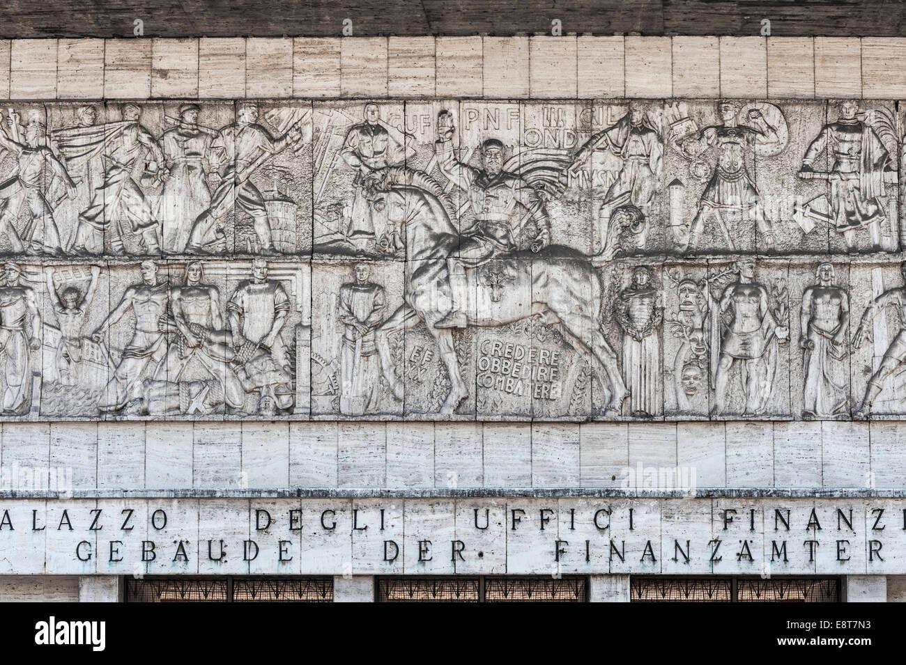 Monumental frieze, Mussolini as a Roman emperor on horseback, Casa del Fascio former party headquarters of the fascists - Stock Image
