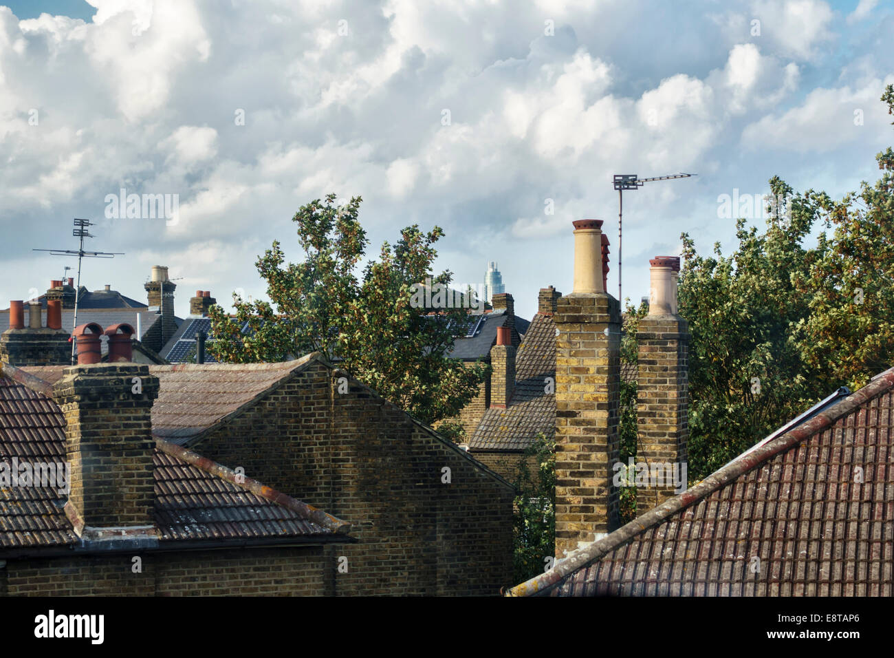 London, UK. A view over the rooftops of Brixton with the St George Wharf Tower in the distance - Stock Image