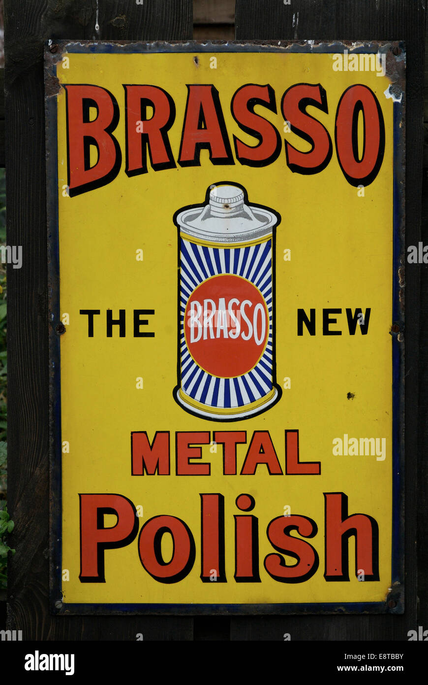 Vintage enameled advertising signs on metal sheets still can be found attached to buildings often long after the - Stock Image