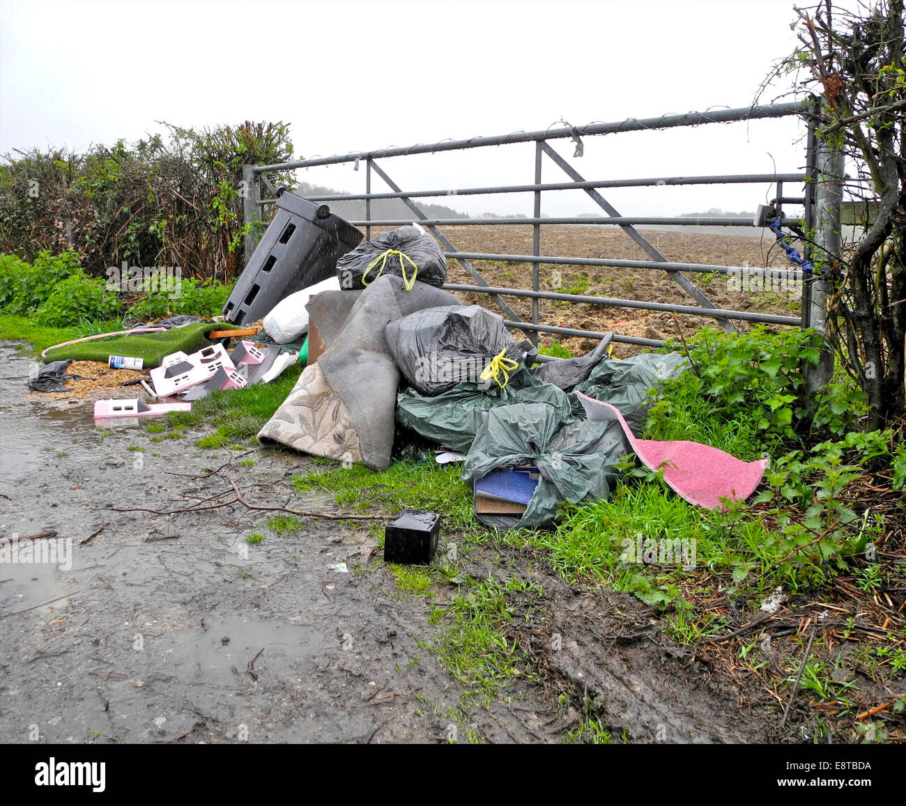 Fly tip tipping  in  farmer's gateway in UK countryside. From the archives of Press Portrait Service (formerly - Stock Image