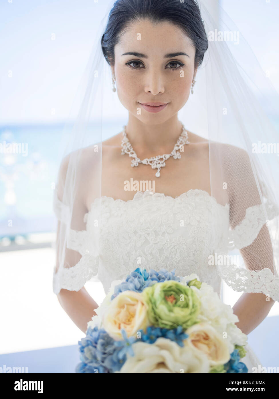 Mixed Race Asian American Bride In White Wedding Dress At