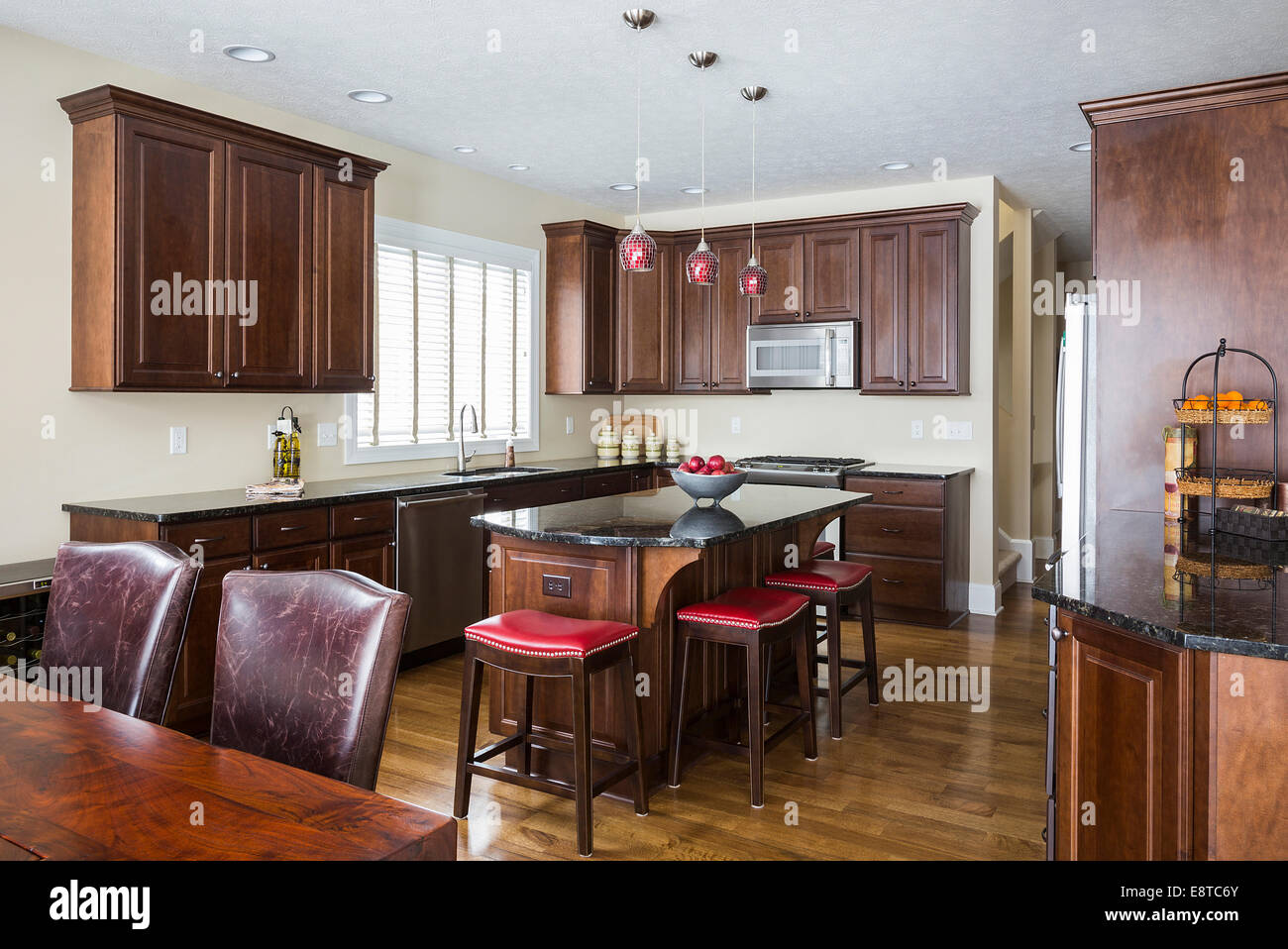 Kitchen Island Table And Cabinets In Modern Kitchen Stock Photo Alamy