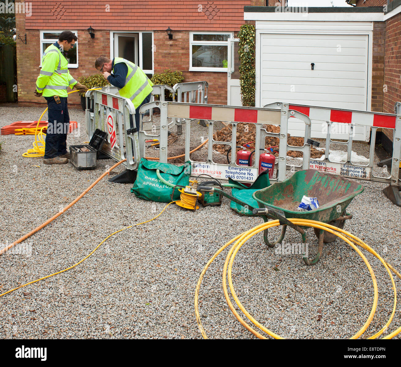 Engineers repairing a domestic gas leak. - Stock Image