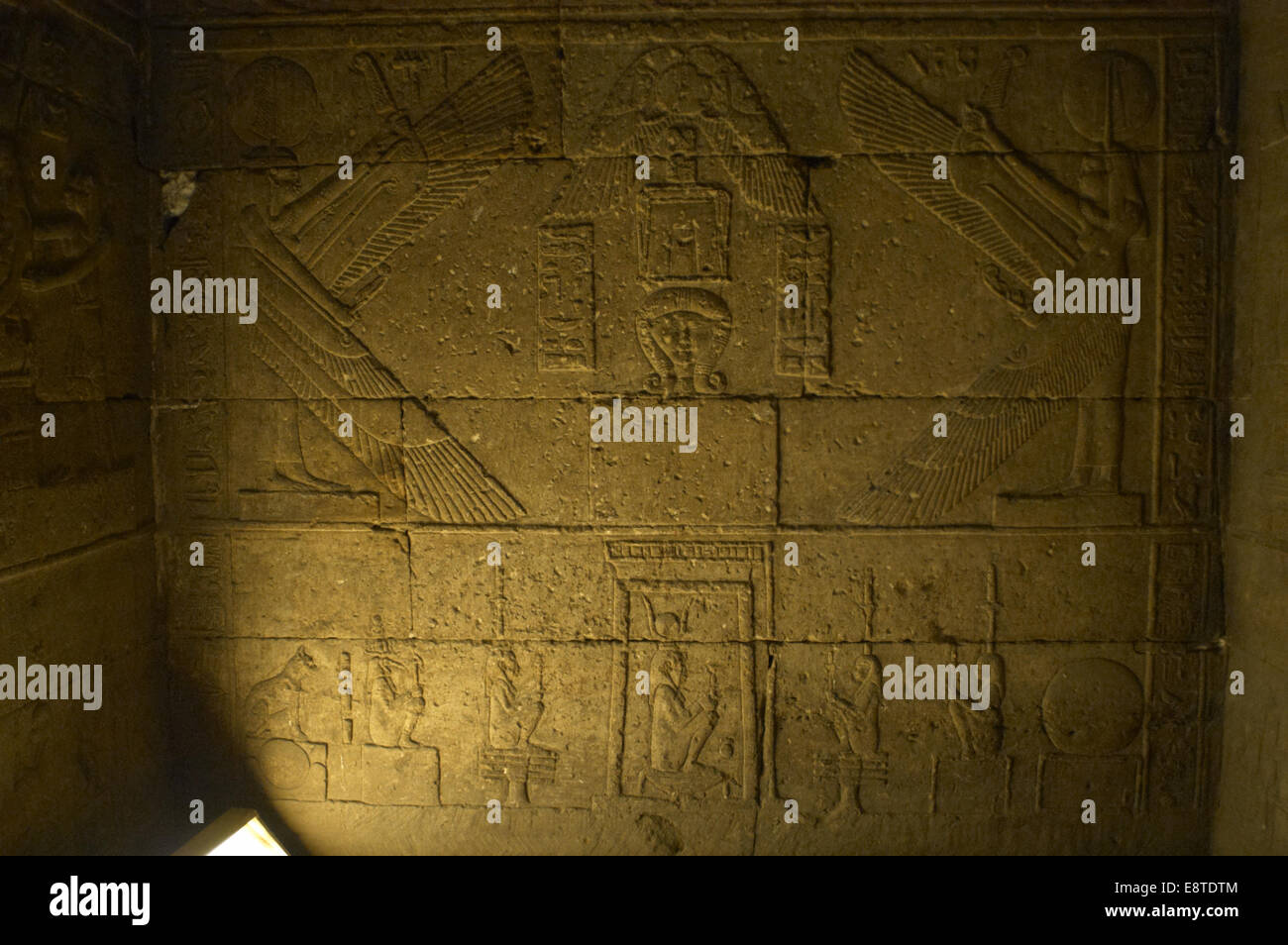 Egypt. Dendera. Hathor Temple. Cult to the goddess Hahtor next to Maat and isis. At the bottom, deity in a shrine. - Stock Image