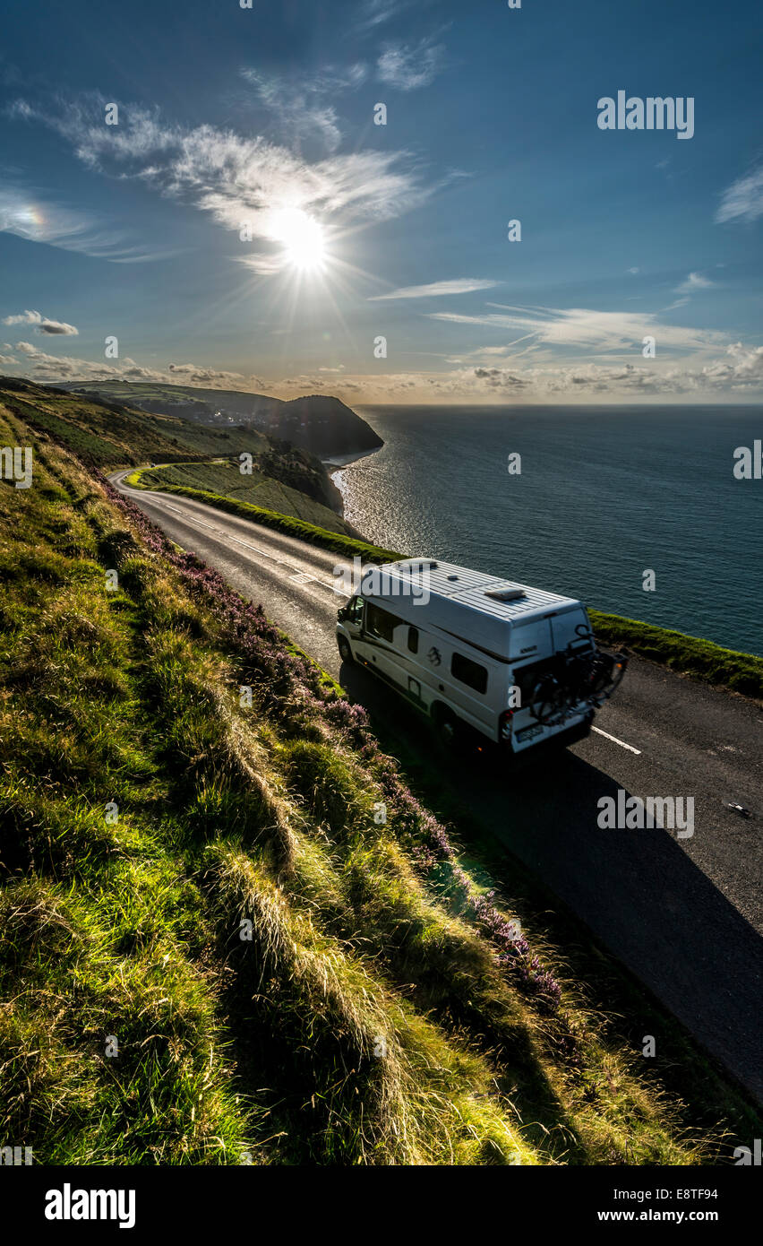 A campervan driving along the scenic A39 coastal road, one of the best drives in the South West, UK - Stock Image