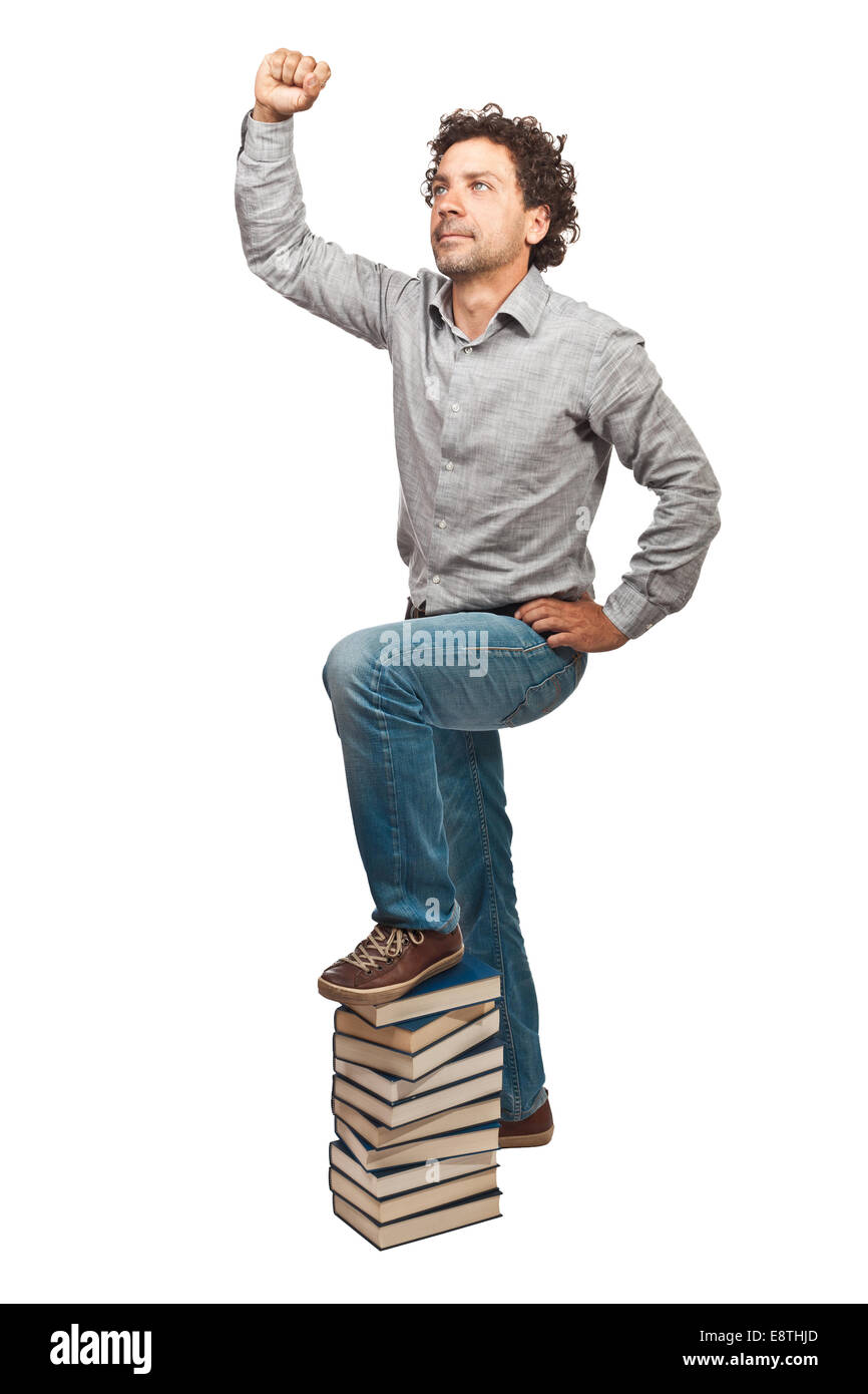 winner man and pile of books - Stock Image