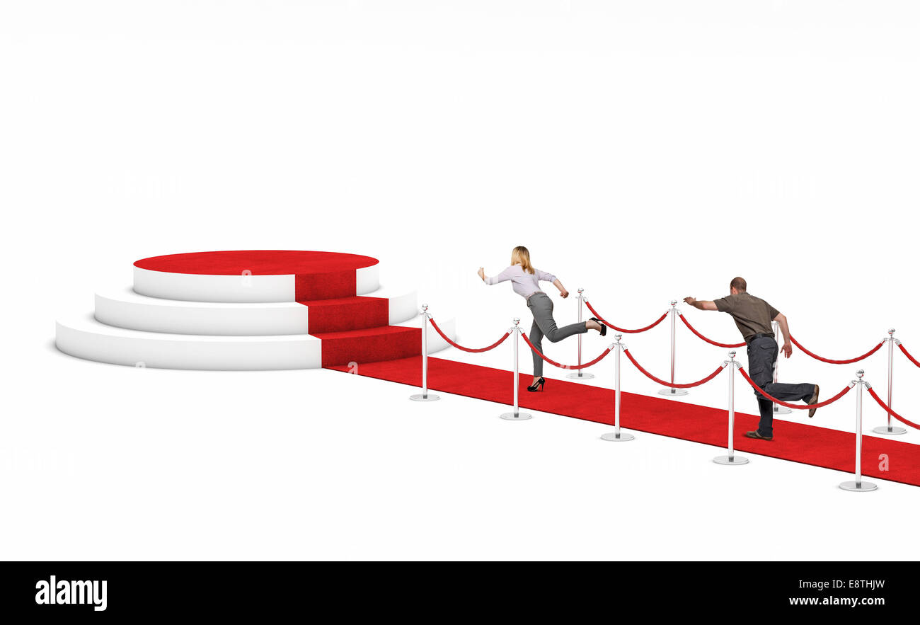 man and woman run on red carpet - Stock Image