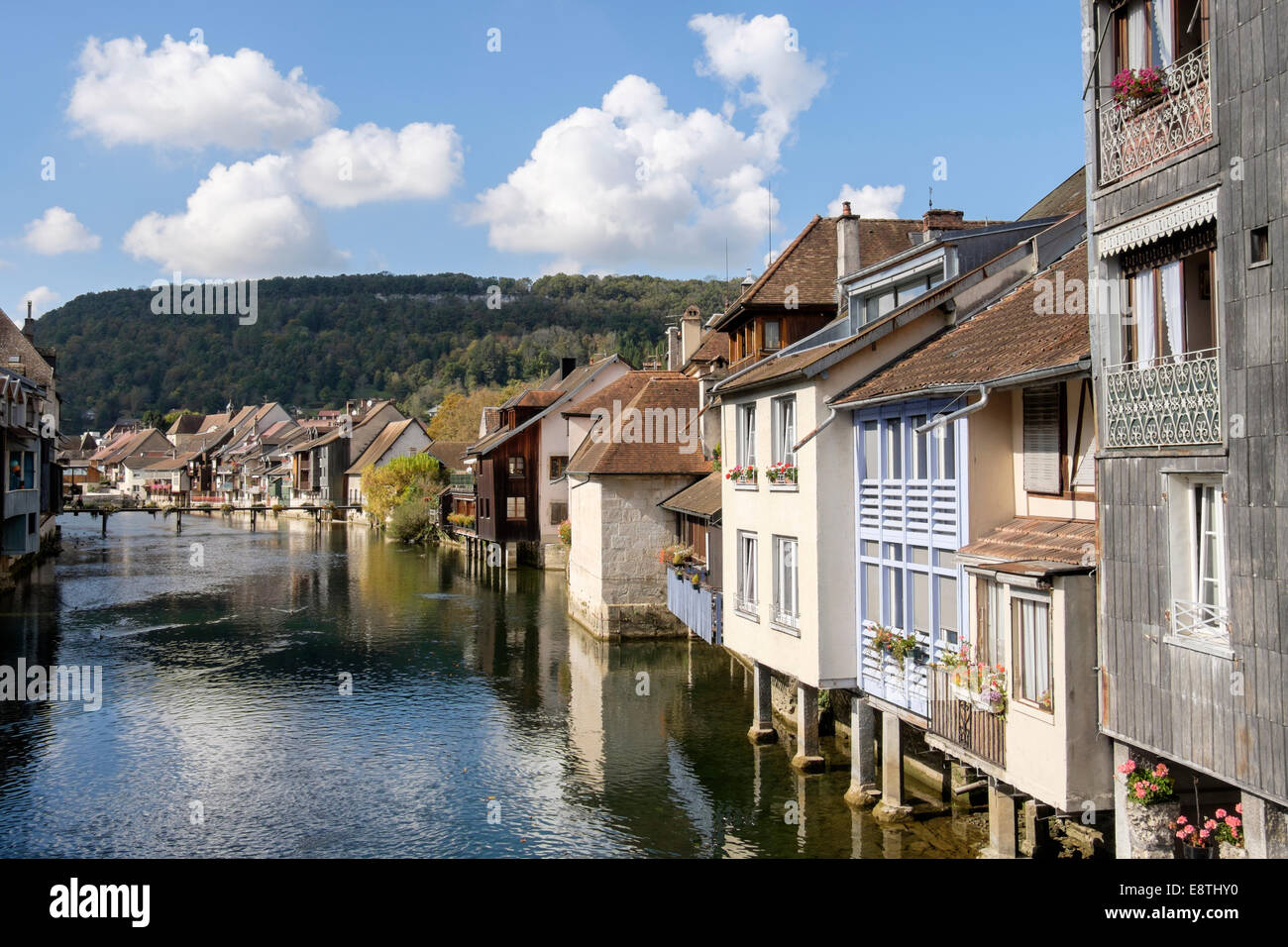 Quaint old houses overhanging the River Loue in Ornans, Doubs, Franche Comte, France, Europe - Stock Image