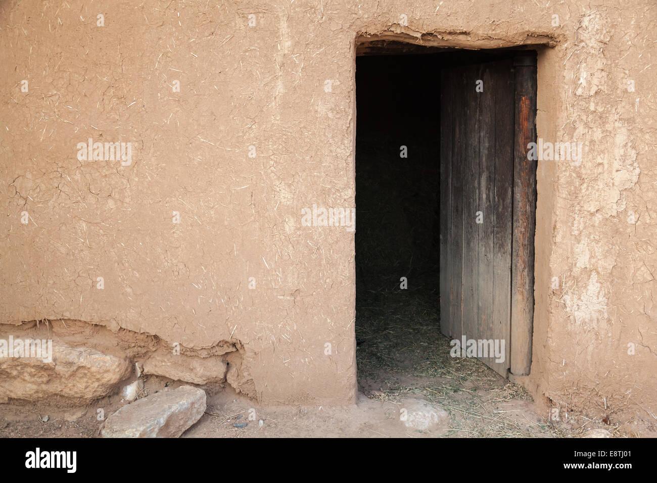 Old rural clay wall with open wooden door. Background texture & Old rural clay wall with open wooden door. Background texture Stock ...
