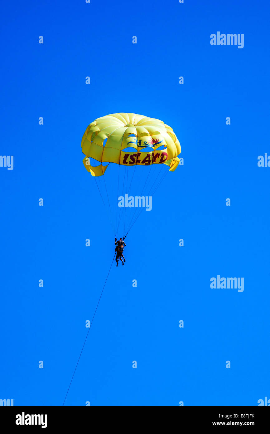 Holidaymakers parascending in tandem off the Tunisian coast. - Stock Image