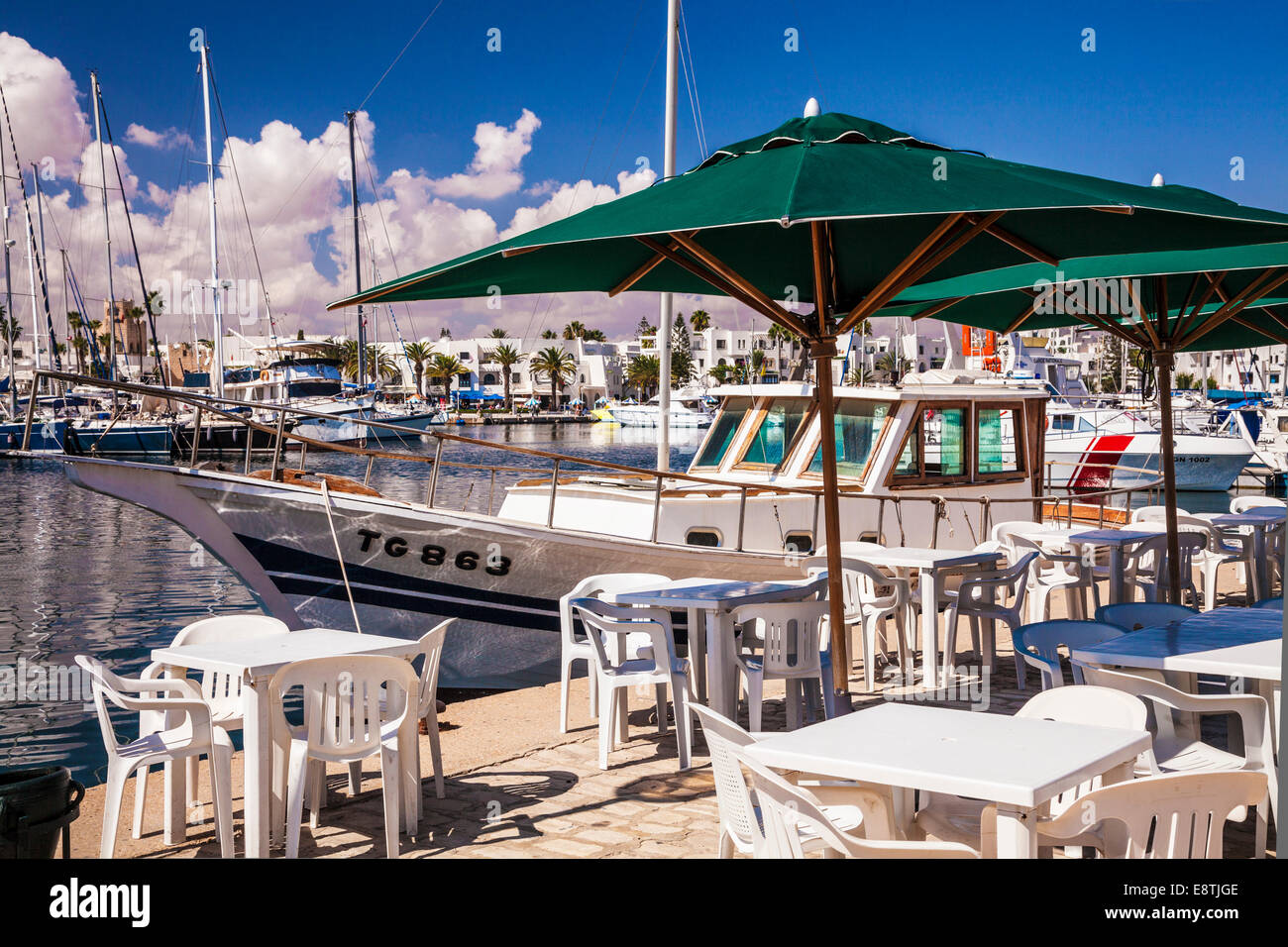 A harbourside cafe at the marina in Port el Kantoui in Tunisia. - Stock Image