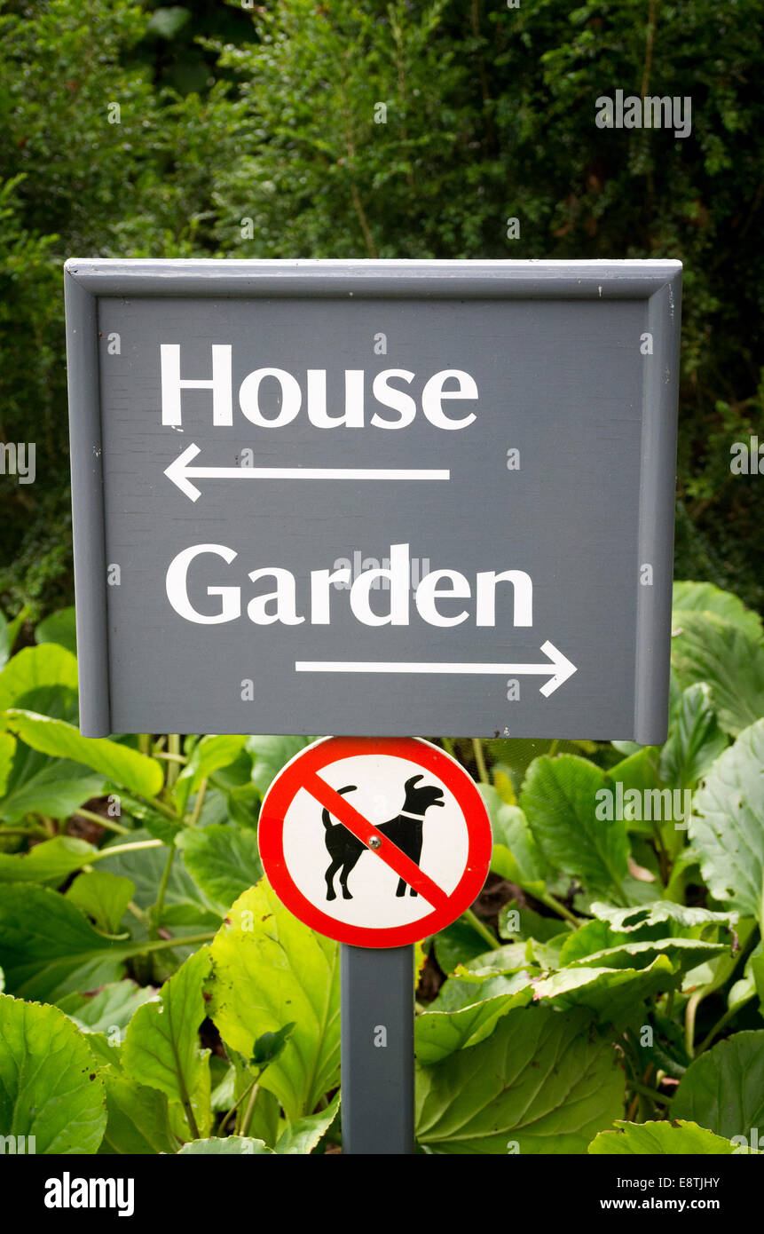 Sign in a garden open to the public showing directions and dog limitations - Stock Image