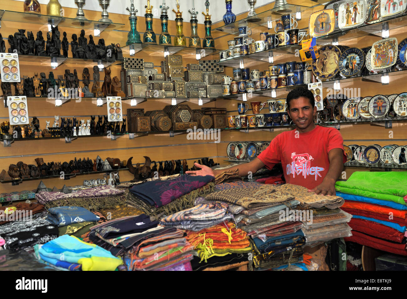 Egyptian shop keeper standing inside his small tourist shop, Nuweiba, Egypt - Stock Image