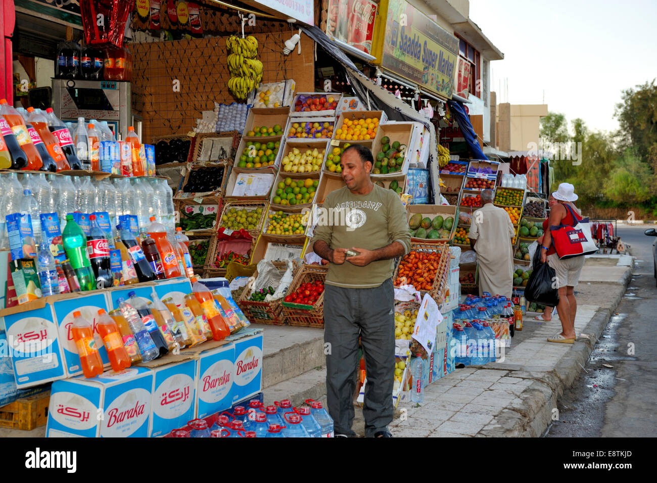 Egyptian shop keepers standing, sitting outside their small shops, Nuweiba, Egypt - Stock Image
