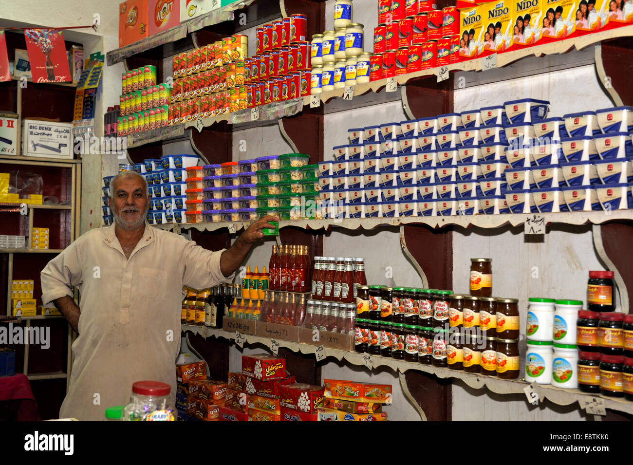 Egyptian shop keeper standing inside his small food shop, Nuweiba, Egypt - Stock Image