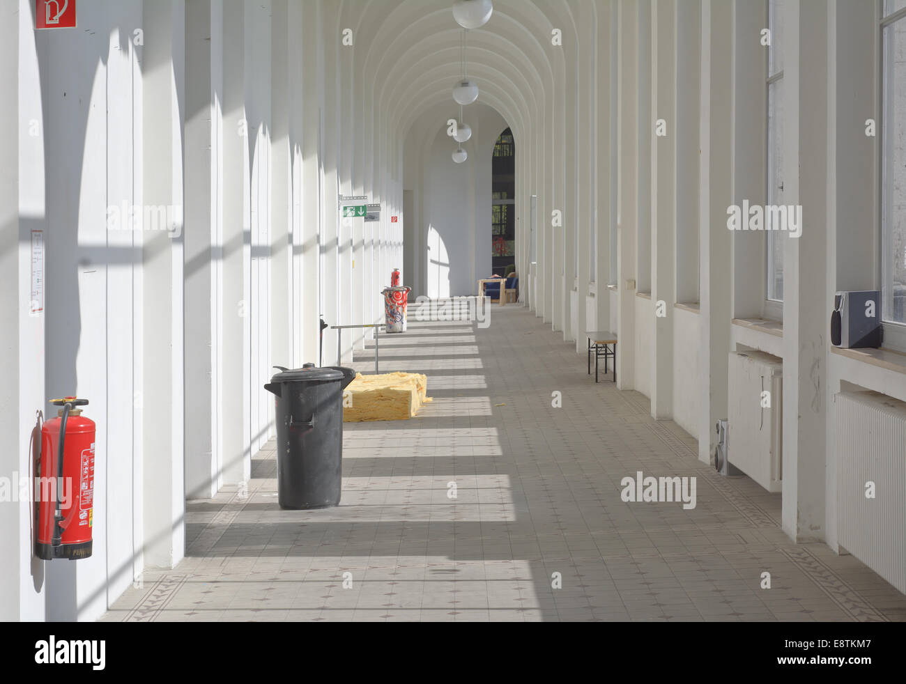 Interior View of Corridor with Trash Can and Workshops - Stock Image