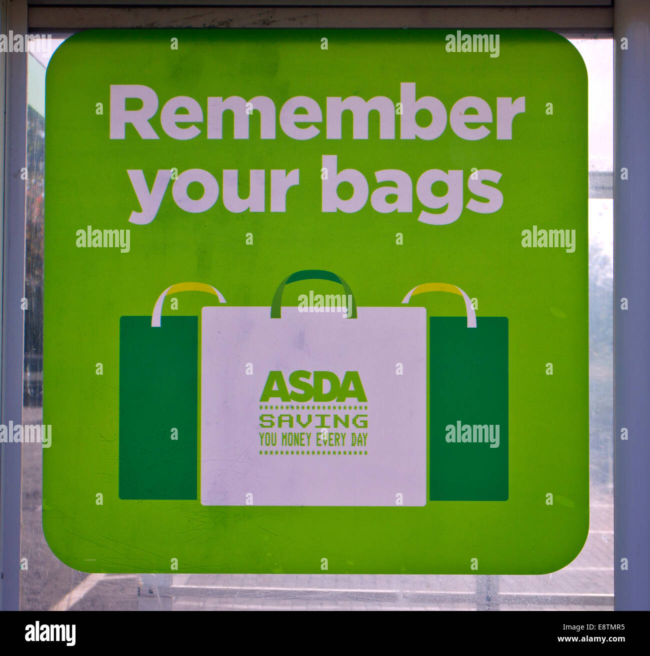 Remember your bags sign in Asda carpark - Stock Image