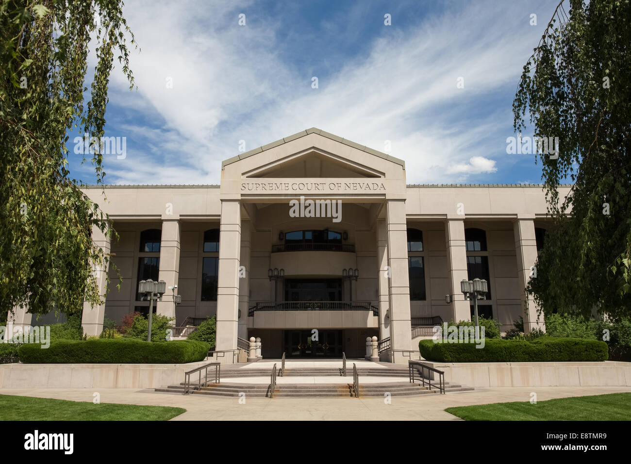 Nevada Supreme Court building in Carson City, the Nevada state capital.  Set against a blue sky.  Horizontal orientation. - Stock Image