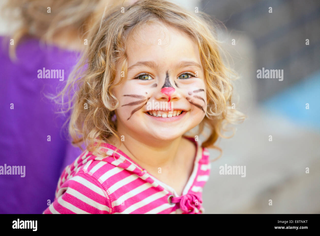 Face paint on young girl at a party. - Stock Image