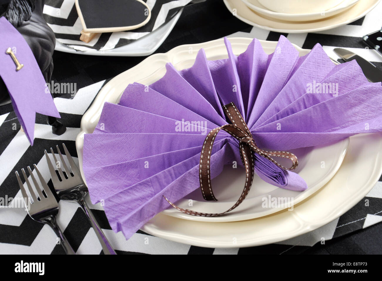 Black and white chevron with purple theme party luncheon table place setting for melbourne cup australian public holiday