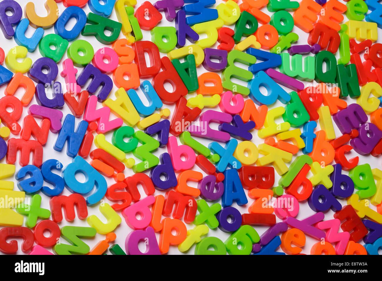 Random magnetic fridge letters - Stock Image