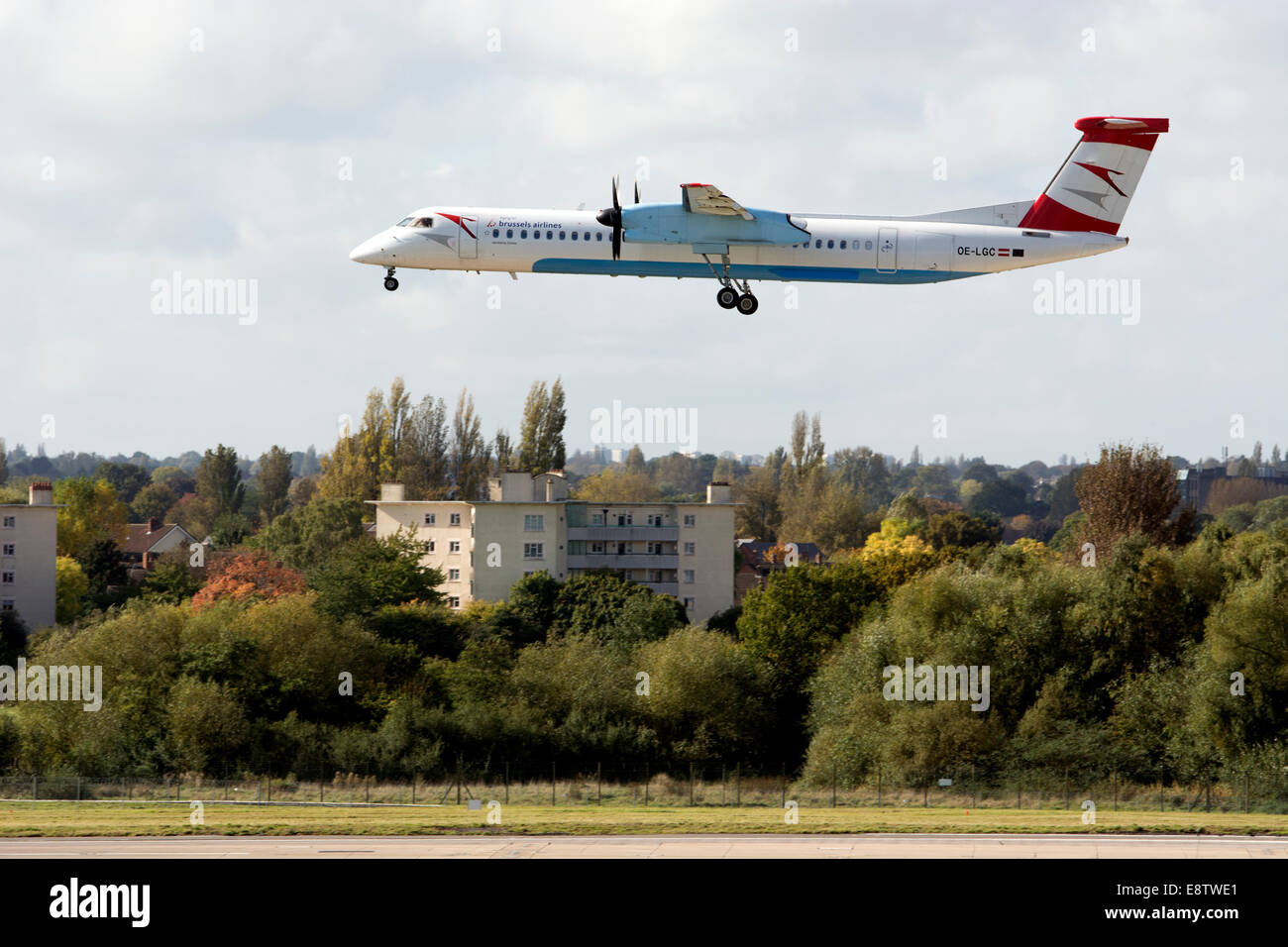 Brussels Airlines DHC Dash 8 aircraft landing at Birmingham Airport, UK - Stock Image