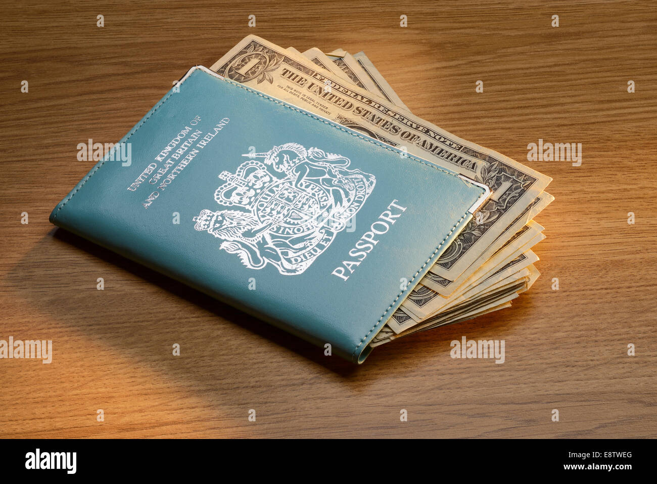 British passport and US dollars - Stock Image