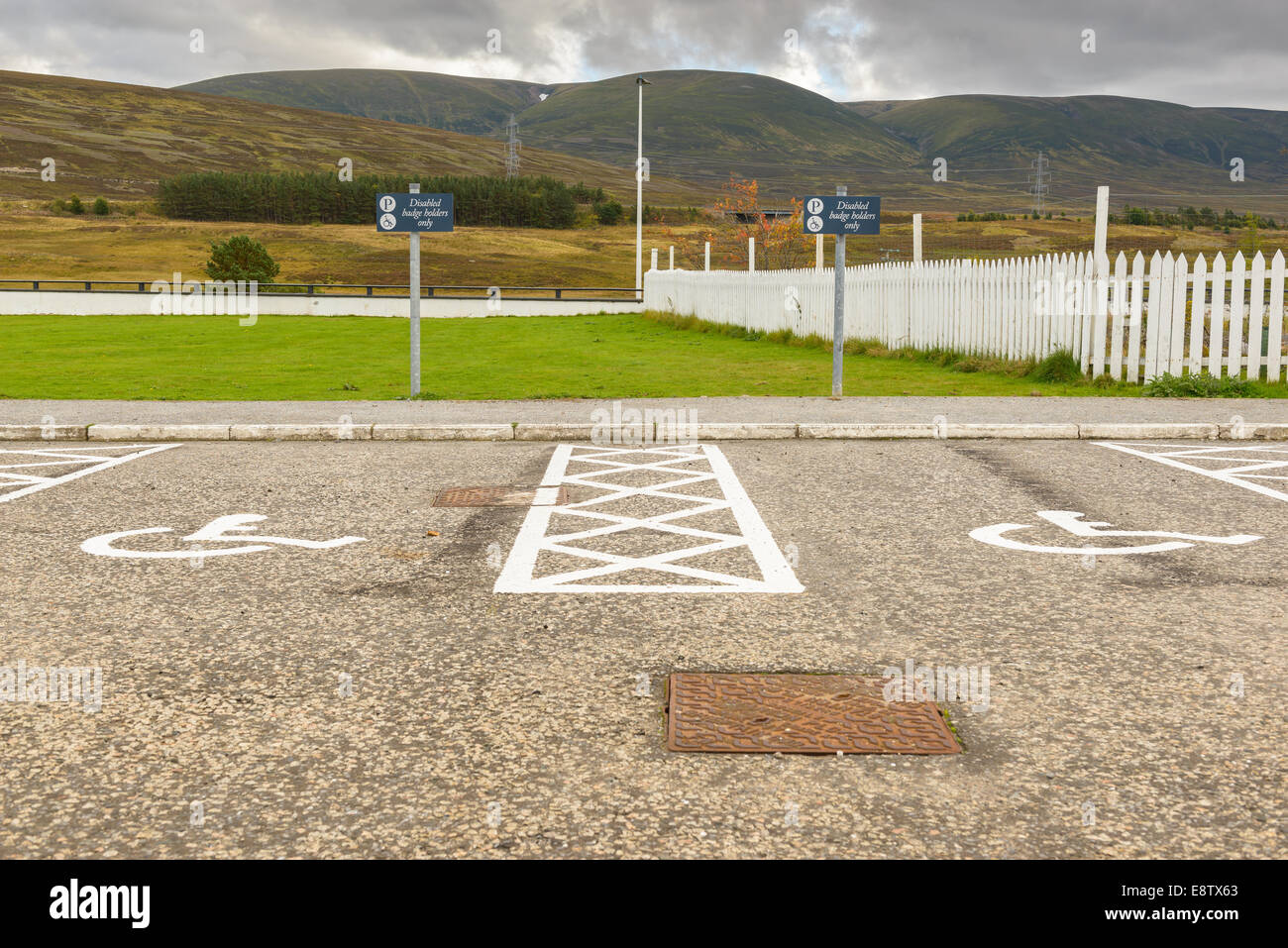Two disabled parking spaces in a tarmac car park, both unoccupied. - Stock Image
