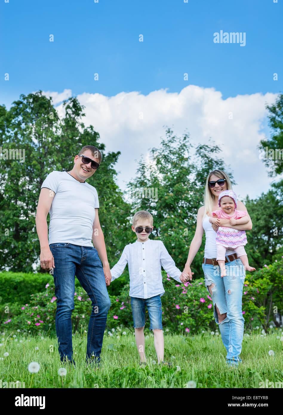 Portrait Of Happy Family In Garden - Stock Image