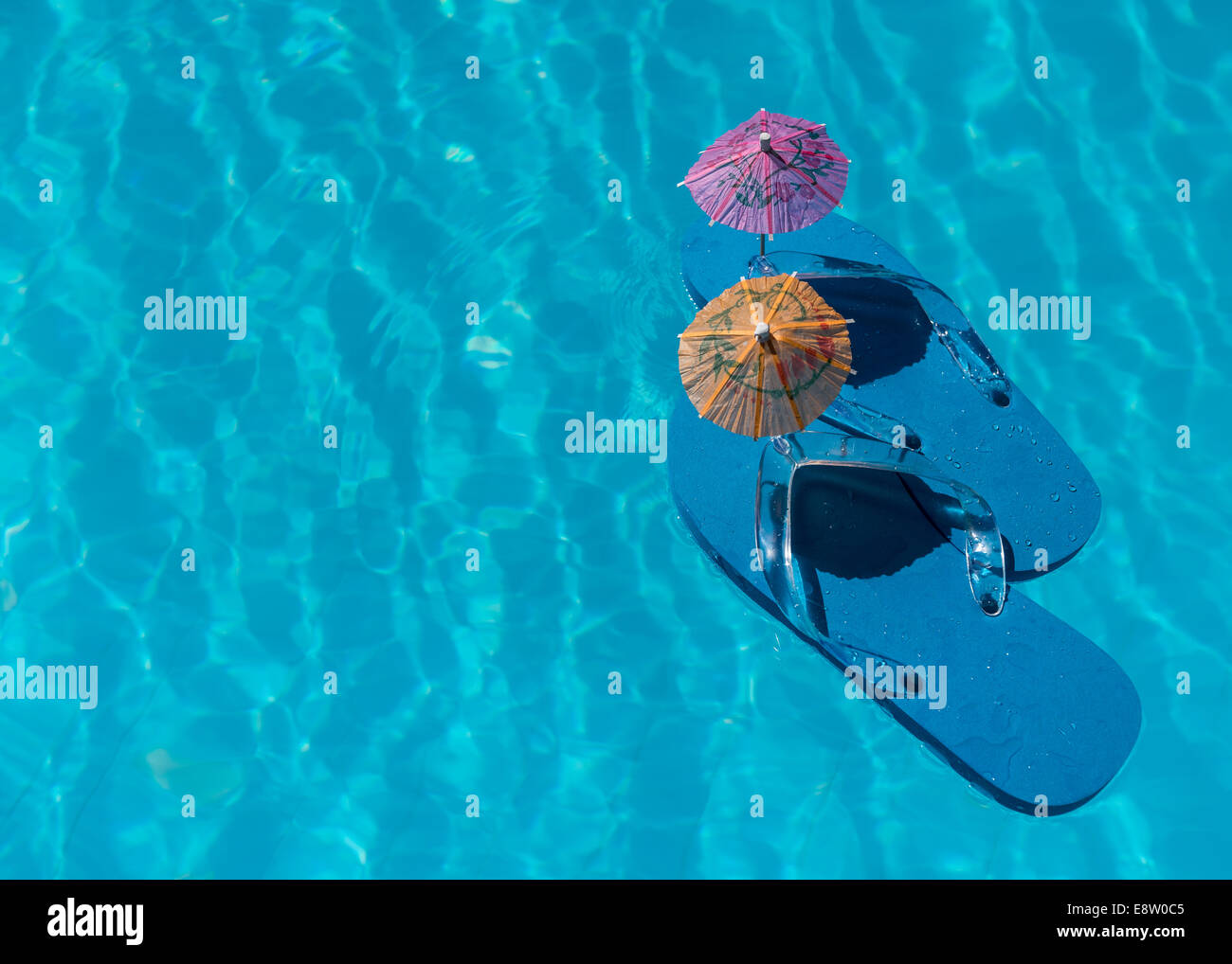 Flip Flop on pool with surface of water background - Stock Image