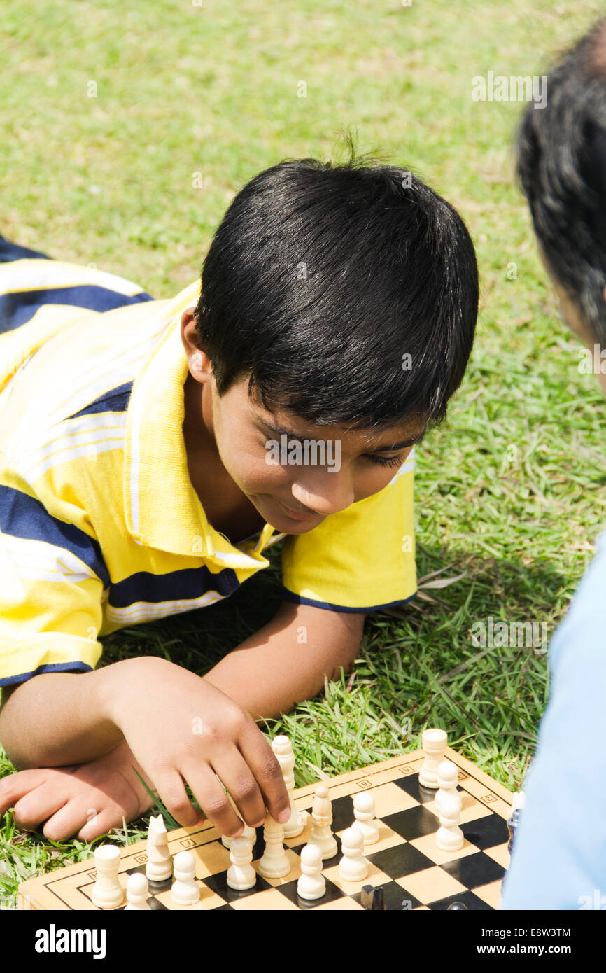 1 Indian Man Playing Chess with Kid - Stock Image