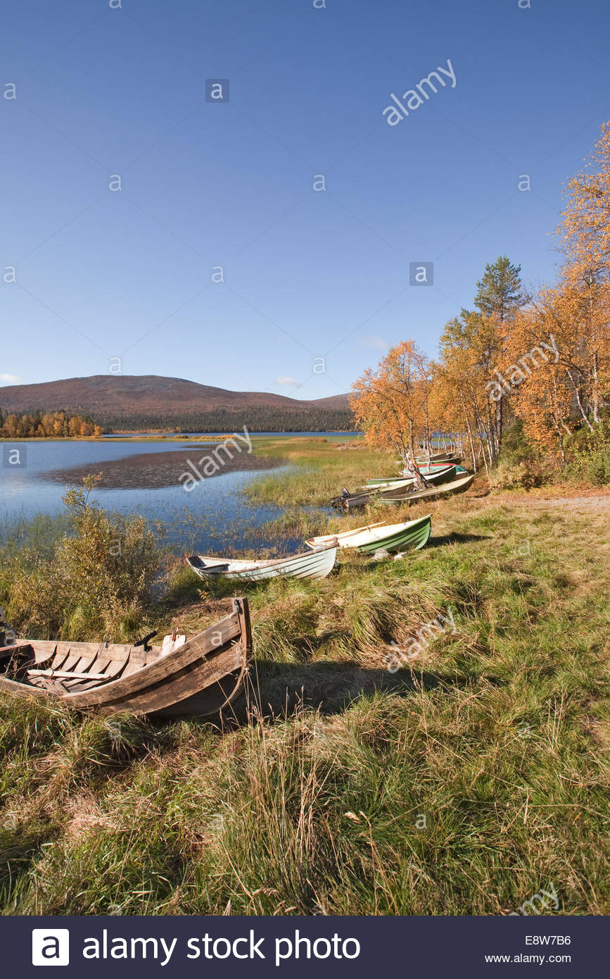 Boats on shore in Lapland - Stock Image