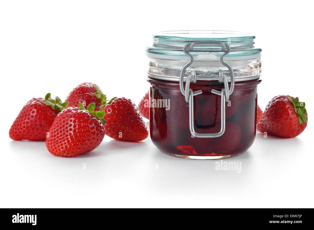 Strawberry jam or confiture and fresh strawberries isolated on white. Sweet red preserve. - Stock Image