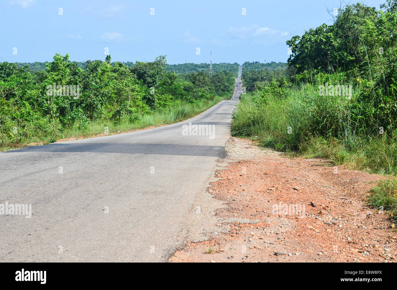 A long road to the horizon in Ogun state, Nigeria - Stock Image
