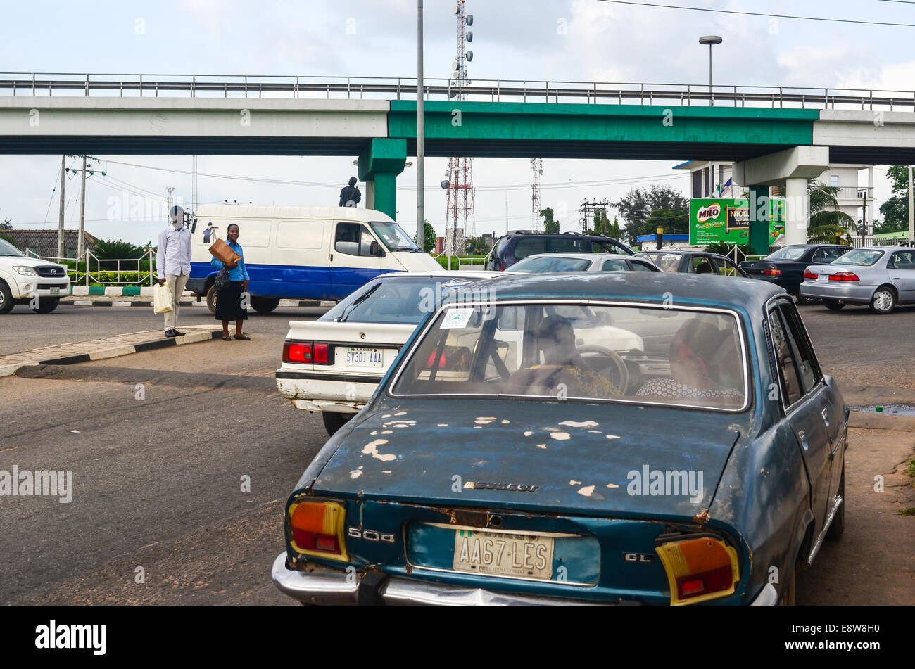 An Old Peugeot 504 And A Bridge Painted With The Colors Of The Stock