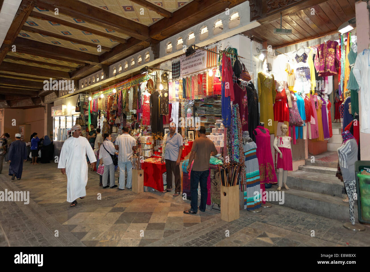 Customers and shops in the Muttrah Souq market, Muttrah, Muscat, Oman - Stock Image