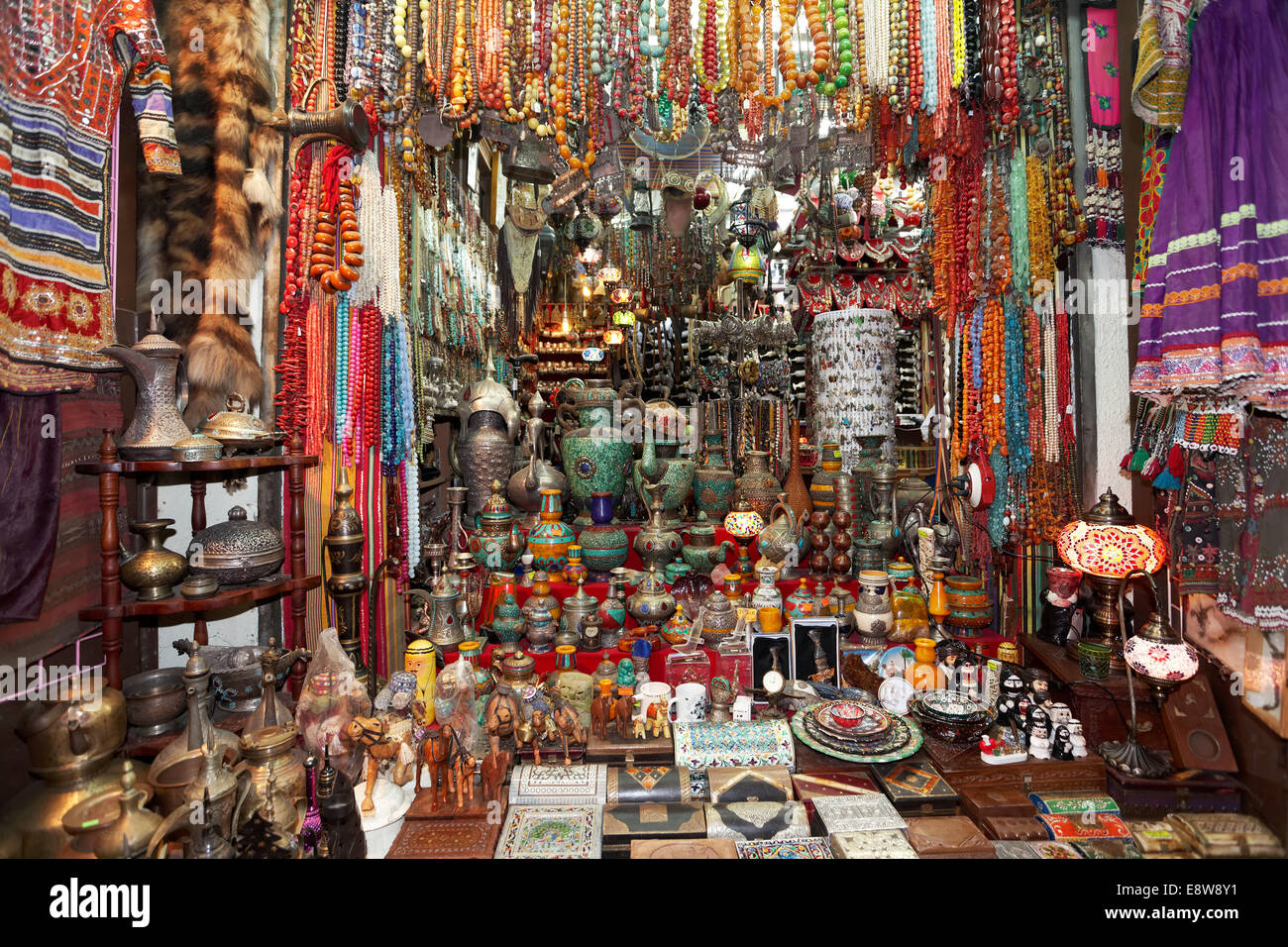 Colourful wares and souvenirs in a shop in the Muttrah Souq market, Muttrah, Muscat, Oman - Stock Image