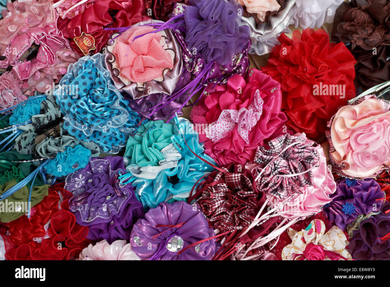 Colourful hair clips in a shop in the Muttrah Souq market, Muttrah, Muscat, Oman - Stock Image