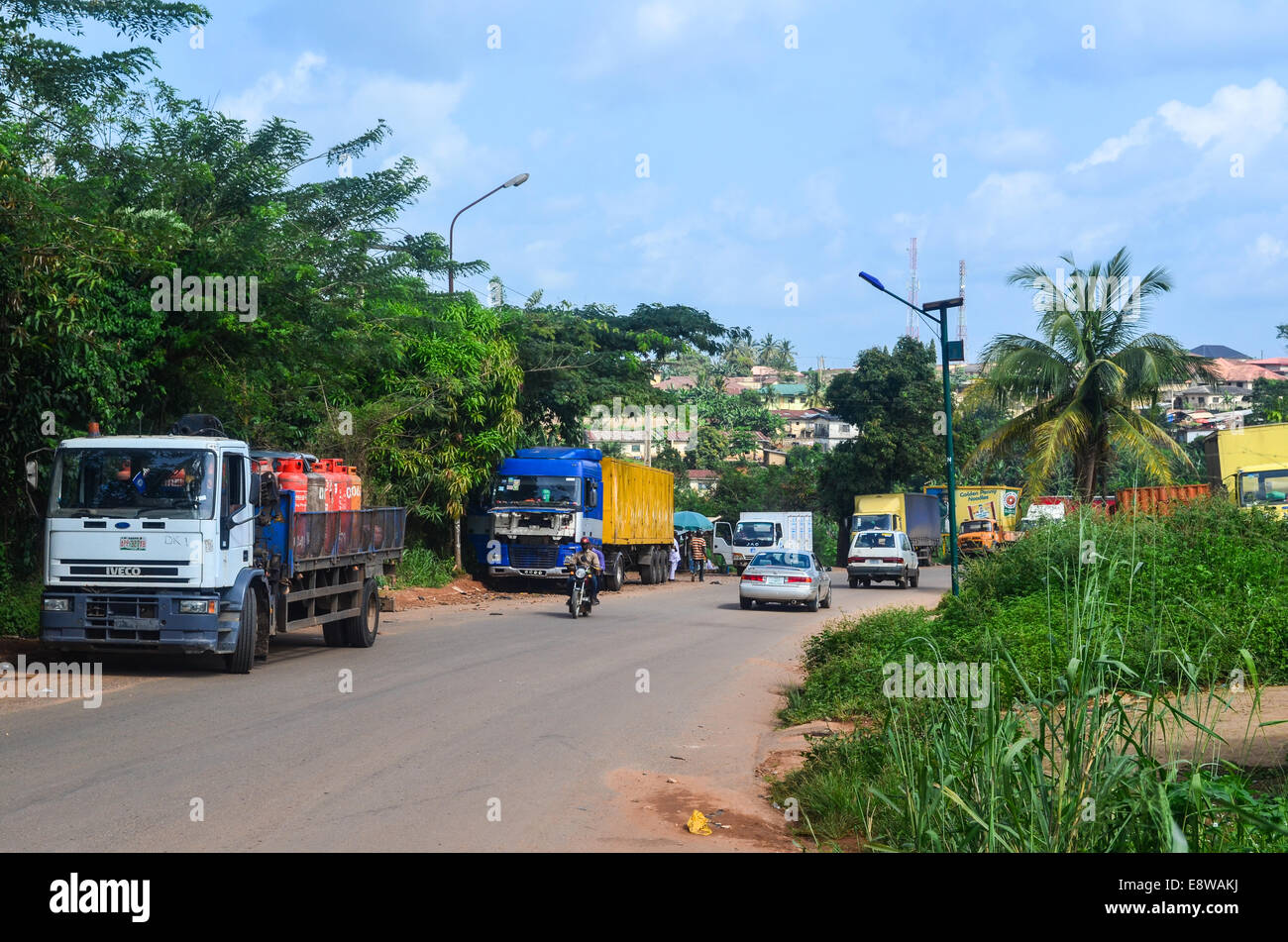 Trucks in the city of Ilesa, Nigeria - Stock Image