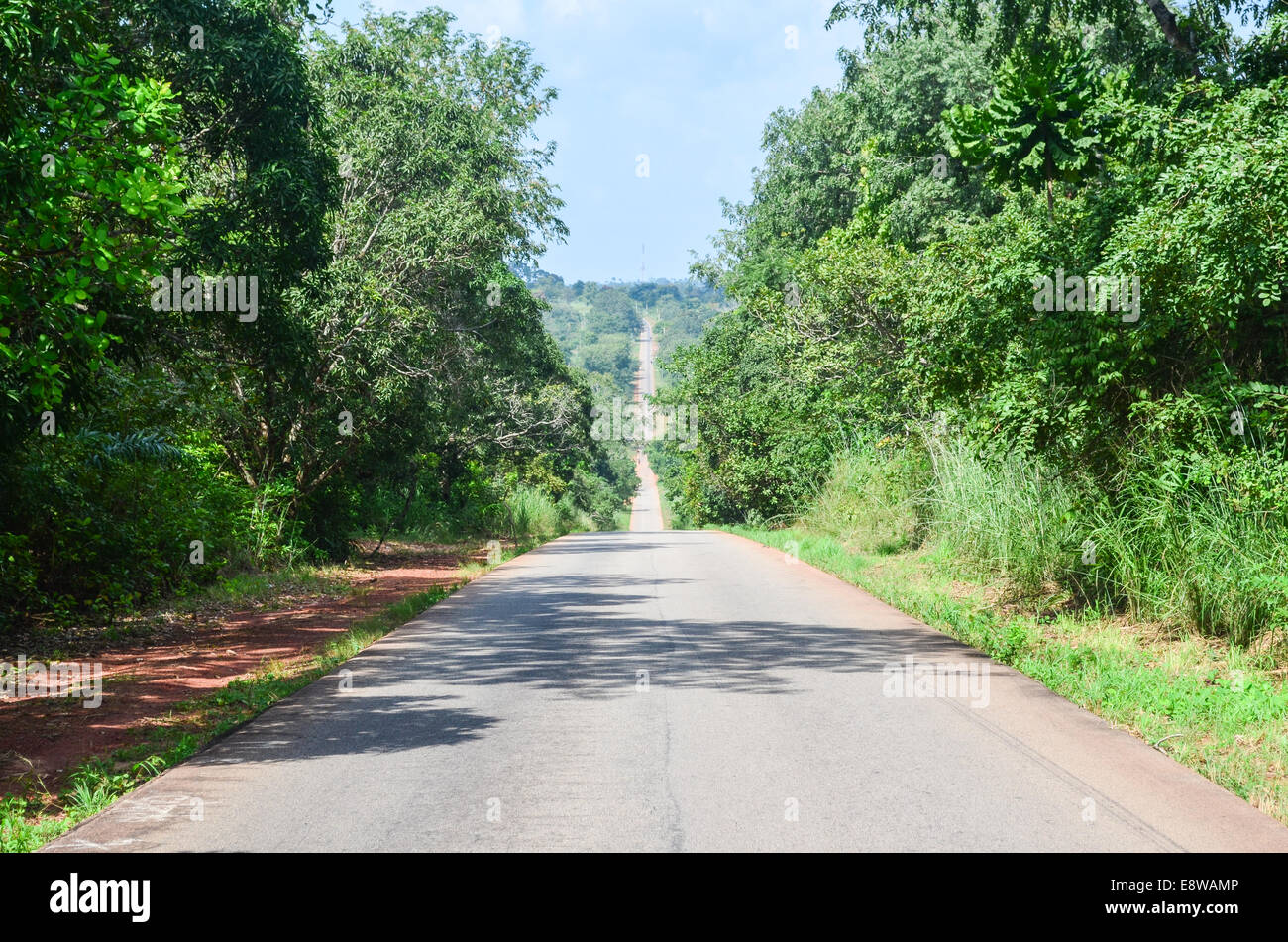 Rural Nigeria, long straight road in Edo state - Stock Image
