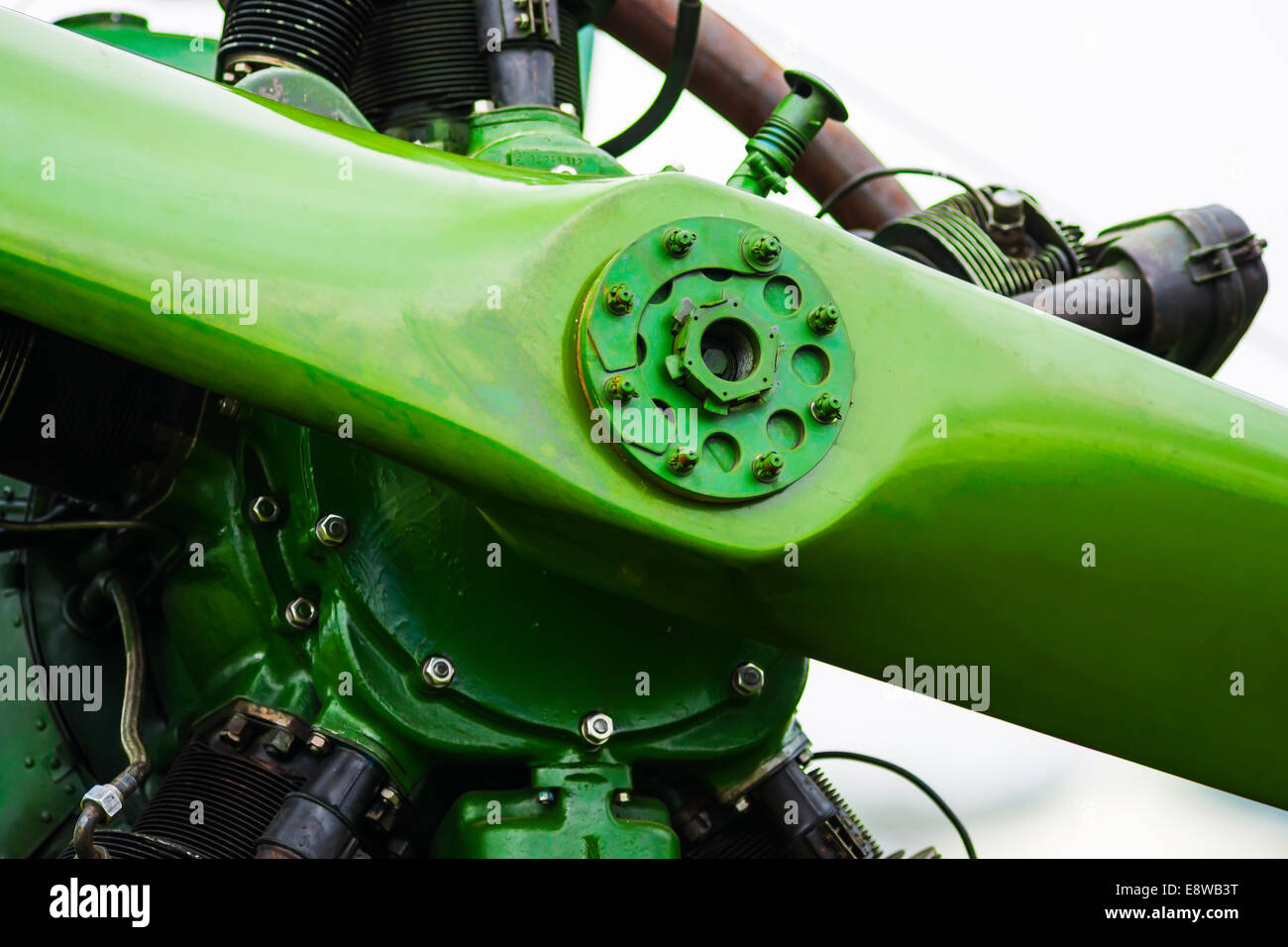 Green Age Of Aviation. Closeup view of the propeller of a vintage airplane. Piston engine, the beginning of the - Stock Image