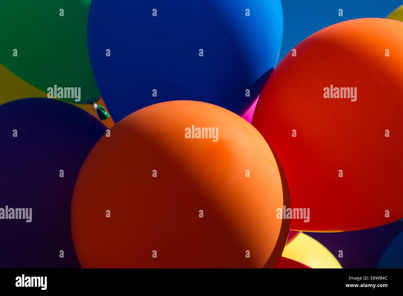 Festive Mood. Closeup view of inflatable balloons of bright and intense colors - Stock Image