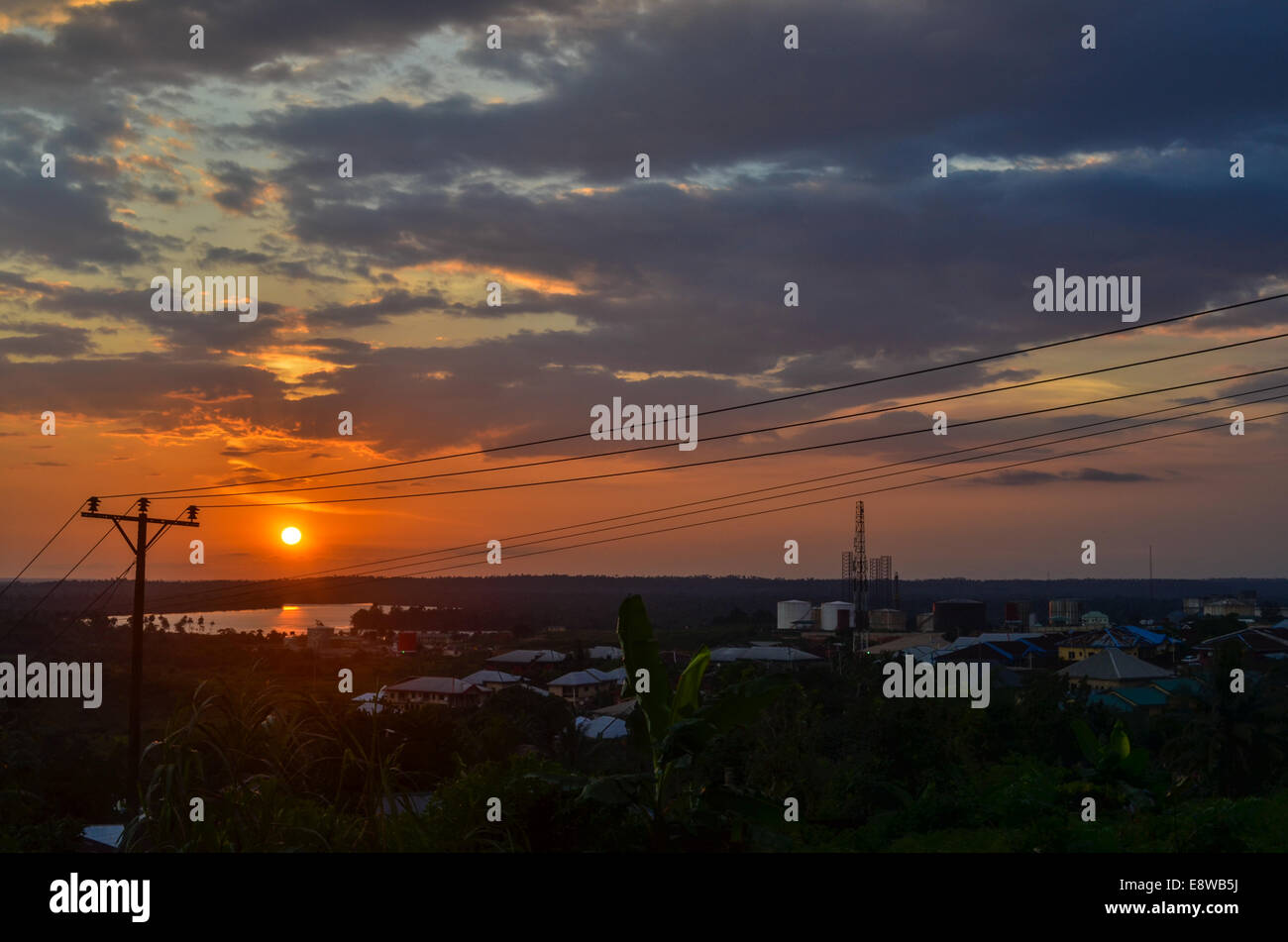 Sunset over Cross River (where the oil pipelines run) and the city of Calabar, Nigeria - Stock Image