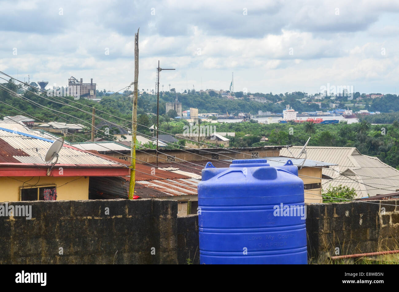 View of the city of Calabar, Nigeria, and boat in the Cross River - Stock Image